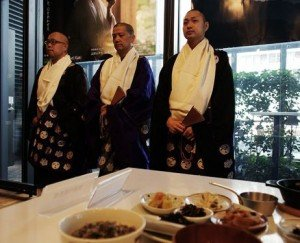 Monks from Koyasan in Wakayama Prefecture attend the opening of Koyasan Cafe, a religious and culinary event in Tokyo continuing until Sept.8 at the Shin-Marunouchi Building across from Tokyo Station.